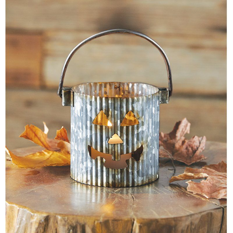 Pumpkin Tin Votive Holder Love this cute halloween decoration idea - halloween decoration themes