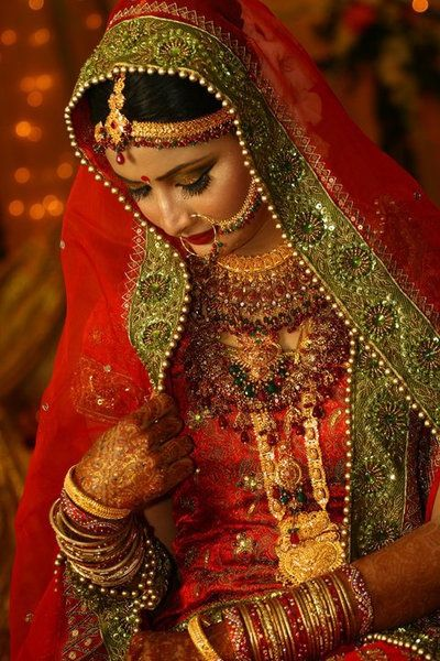 traditional indian bride wearing bridal lehenga and jewellery, indian wedding photography