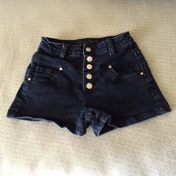 High-Waisted Button Fly Shorts Cute navy fifties-style high waisted shorts with a button fly. It is listed as a 3/4, but it is just a little small on me and I tend to be between a 2 and 3-4 in jeans, so I'm going to list it under size 2. If you're familiar with the brand it may fit like other 3/4 sizes they offer. It's adorable with tie-waist tops. OFFERS WELCOME. BUNDLE AND SAVE. Delias Shorts Jean Shorts