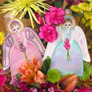 #Angels   Free standing Mylar angels for Easter. Are you looking for a special design to gift for Easter?  Mylar Spring Lily Angel is perfect for Easter, perfect for Spring and perfect for those summer brides too! Stitch and gift today & Save 20% off with code: NLE20 http://needlelittleembroidery.com/item_290/MYLAR-SPRING-LILY-ANGEL.htm