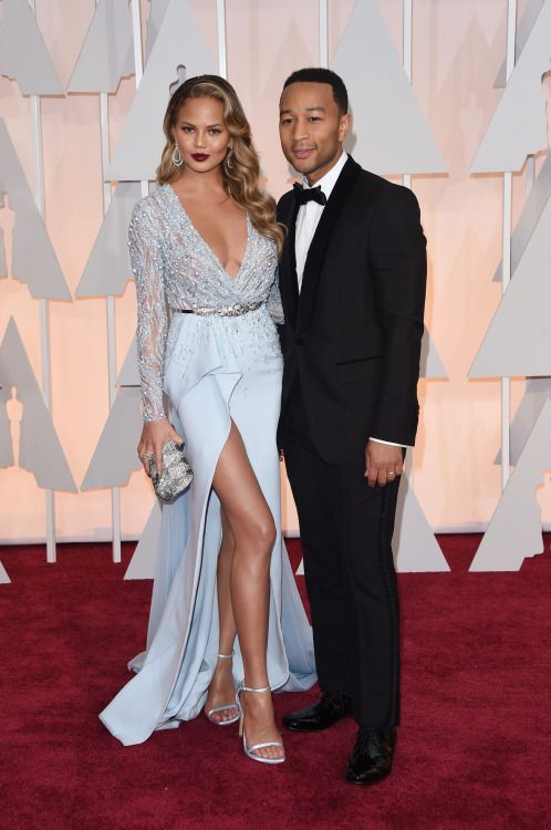 Chrissy Teigen and John Legend attend the 87th Annual Academy Awards at Hollywood & Highland Center on February 22, 2015