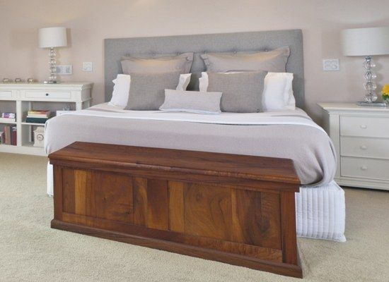 Long Wooden Tv Lift Cabinet At Foot Of The Bed