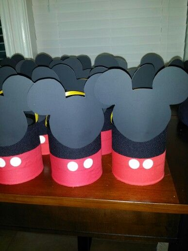 Mickey mouse party favors...this were made out of recycled  baby formula cans..covered with fabric and the buttons are white sticker labels..very simple and not costly at all..they turned out pretty cute and I filled them with lots of candy..