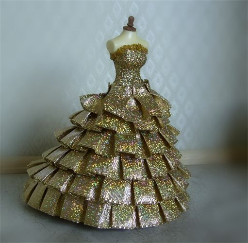 """Gold Dust. SORRY I HAVE JUST SOLD. WOW a stunning holographic pleated ribbon ballgown. The colours are mind blowing on this fabulous gown. """"Twinkle twinkle little star"""" Created and lovingly made on a 5 inch top quality mannequin."""