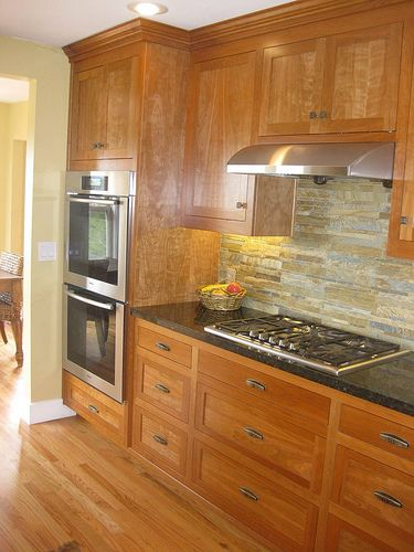 Attractive Cabinet Color/style Is Great Also Stacked Stone Back Splash To Go With  Fireplace