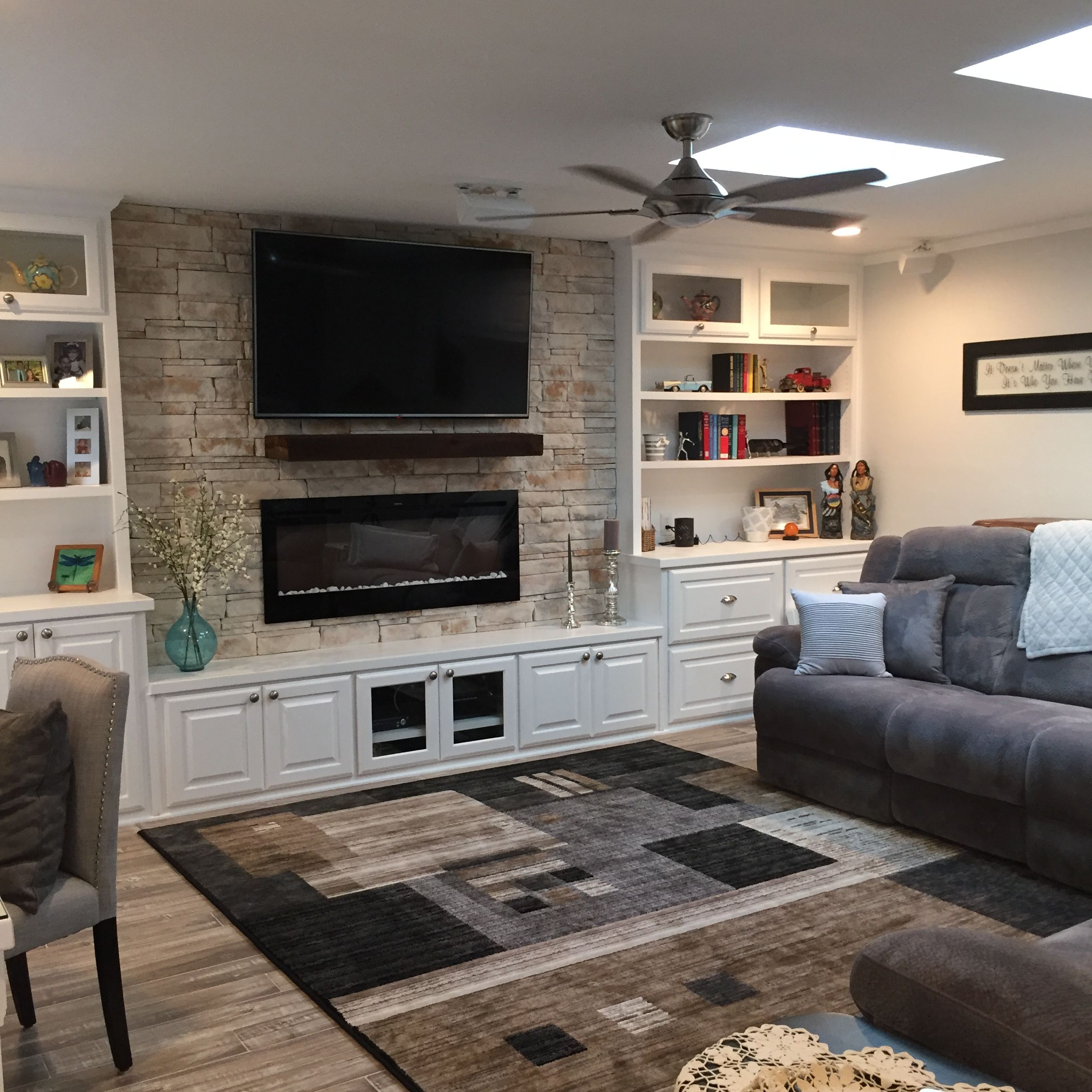 Love My New Built In Cabinets Skylights Fireplace Big Screen Tv And Rock Wall Built In Cabinets Living Room Tv Wall Living Room Furniture Layout