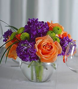 Fiery Orange Roses Couple Well With Vibrant Purple Stock While