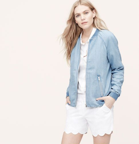 """Straightforward cool, this creamy chambray piece is a wardrobe-changer. Crew neck. Long raglan sleeves. Zip front. Zip welt pockets. Ribbed neckline, cuffs and hem. Lined. 22 3/4"""" long."""