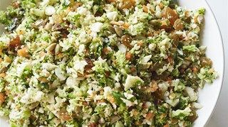 Chopped cauliflower, broccoli, and carrots are tossed with fresh herbs and garlic, golden raisins, toasted pumpkin seeds, olive oil, and cider vinegar.