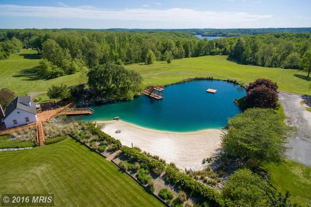 Sand bottomed 1 acre swimming pond with beach in md for 1 acre pond design