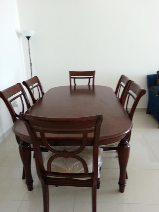 1800 AED Dinning Table And Six Chairs From Home Center