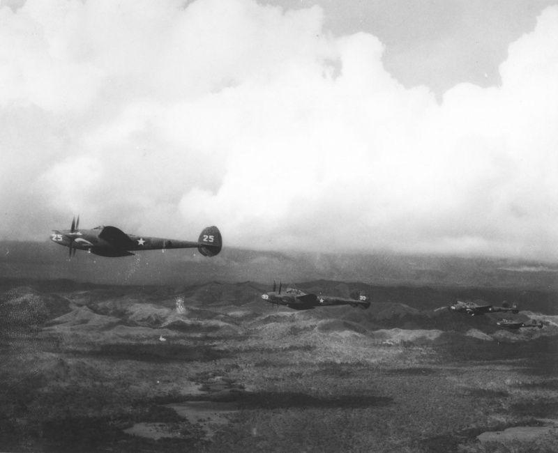 "Escort fighter P-38 ""Lightning"" in flight over New Guinea"