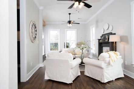 In the living room, the original hardwood floors were retained and refinished. The drop ceiling was removed, bringing the ceiling back to its original height.
