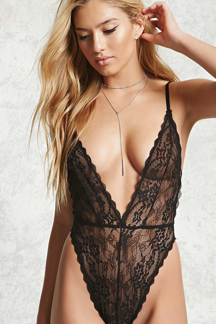 accf9d328048f7 A sheer lace bodysuit featuring a deep V-neck