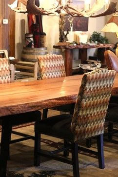 Upholstered Dining Room Chairs Rustic Table Made Out Of Redwood With Metal Trestle Base Antler Chandelier And Area Rug