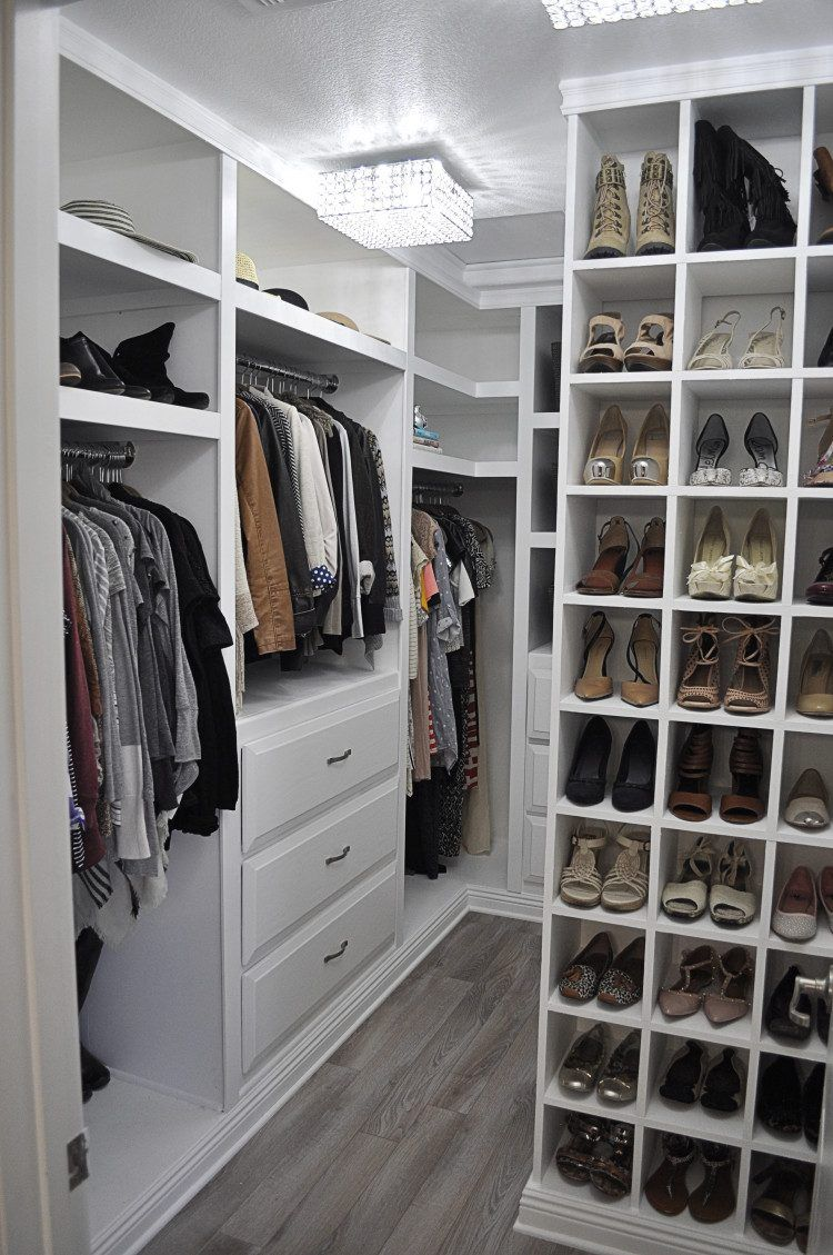 Very well organized walk in closet with white cabinets and storage units closet - Closet storage ideas small spaces model ...