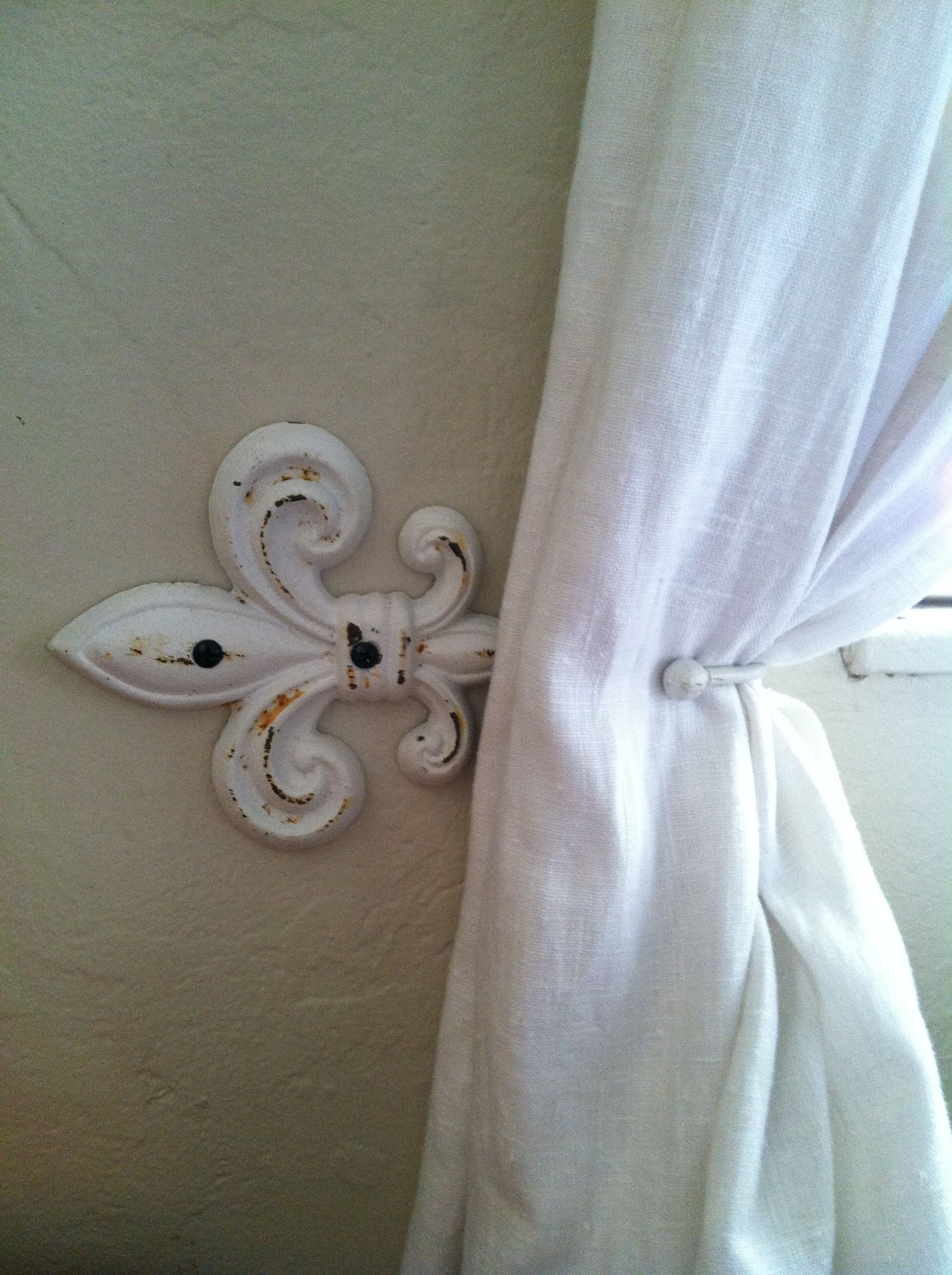 Use A Decorative Hook And Hang It Sideways As A Curtain Holdback