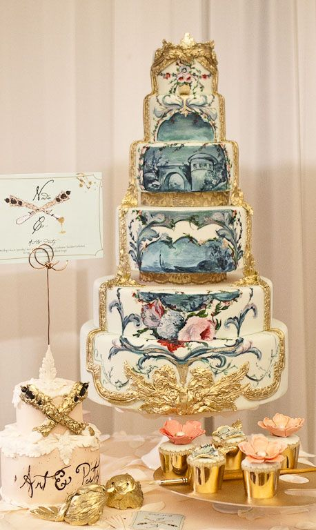 White and gold Baroque wedding cake with blue hand-painted garden scene. Real cake art. By Nadia Colella of Nadia & Co, Canada