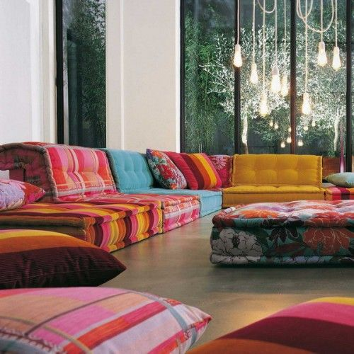 Floor pillows and funky lights for the sun room spaces