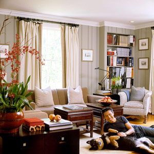 Grey Walls, Linen Curtains, Camel Sofa, Brass/gold Frames, Paneling,