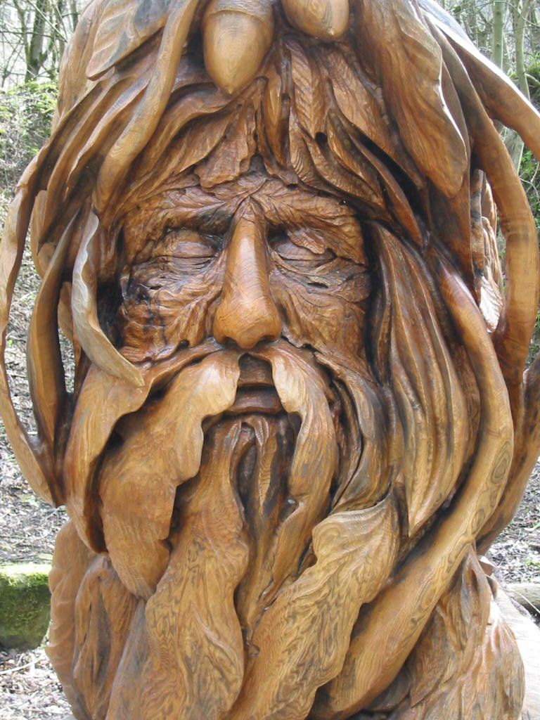 Green man tree stump carving in derbyshire england by