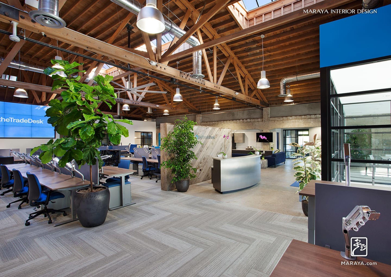 The Trade Desk. Open wood trusses in modern open office