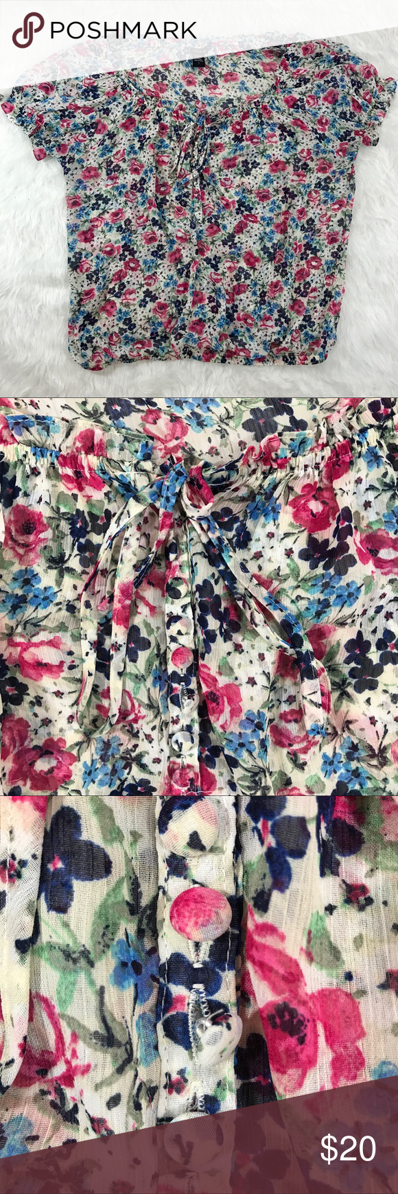 """Torrid Floral Sheer Blouse Cap Sleeve Torrid Floral Sheer Blouse Cap Sleeve. Blouse has a front tie and buttons a quarter of the way down. Torrid size 1. Elastic on hem of shirt and sleeves.   {Measurements laying flat} Armpit to armpit: 26"""" Length: 26""""  ❌No Trades❌ 📦Fast Shipping📦 💬Offers Considered💬 🛍10% Off 2+ Items🛍 🎊Suggested User 🎊 torrid Tops Blouses"""