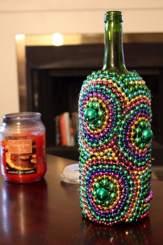 I made these mardi gras wine bottles and now they 39 re for for Wine bottle crafts for sale