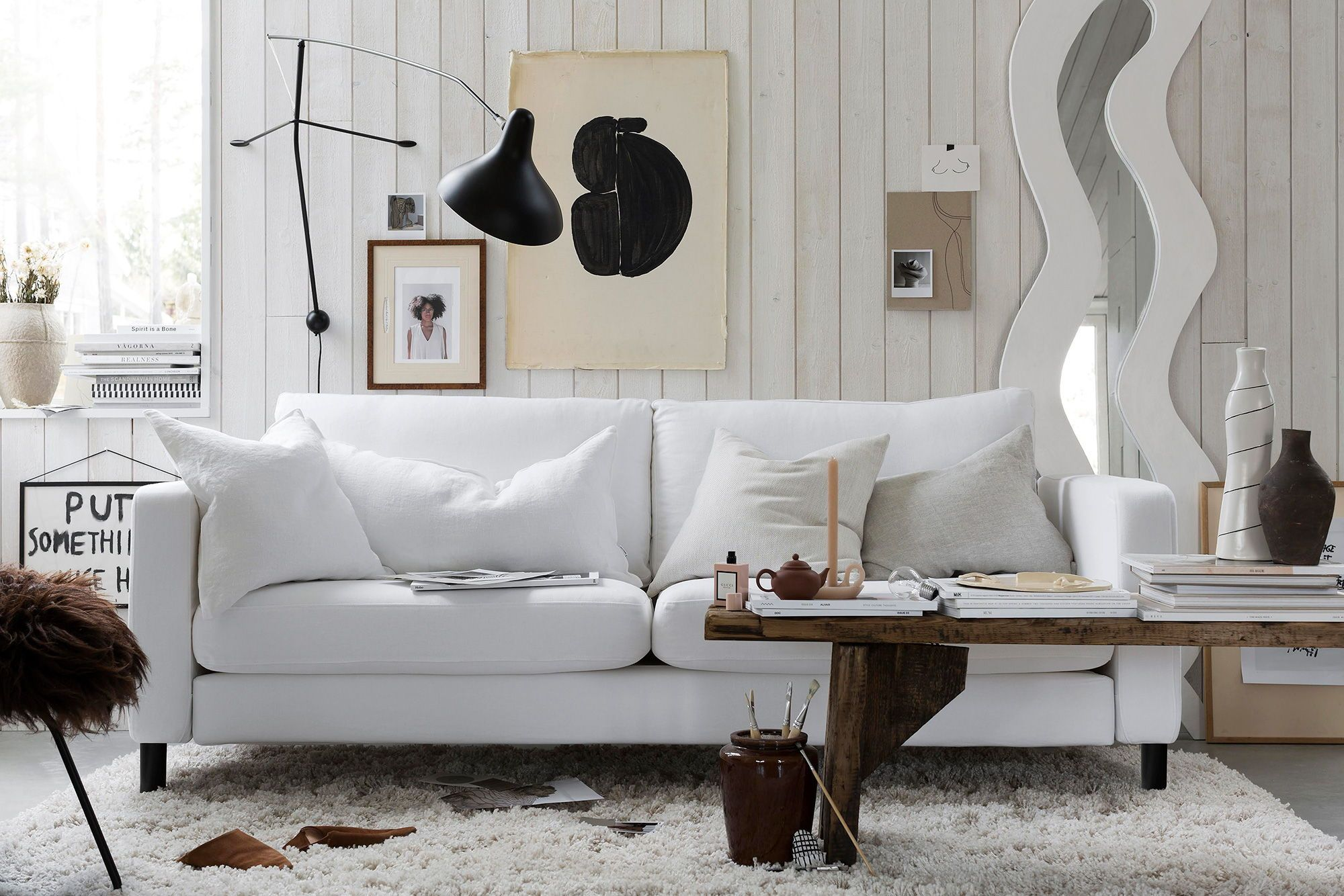 Cosy Layered Scandinavian Boho Vibes In A Neutral White Colour Palette Featuring Graphic Black Accents And White Sofas White Slipcover Sofa Apartment Furniture