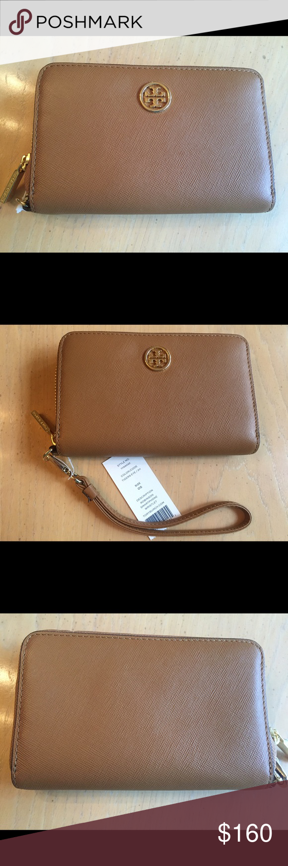 NWT Tory Burch Robinson Smartphone Wristlet NWT 100% Authentic Tory Burch Robinson Smartphone Wristlet.  Tigers Eye Color (Tan). Beautiful Wallet/Wristlet to keep all your essentials organized!  Has compartment for phone, dollar bills, slip pockets for credit cards & zipper pocket for change.  Gold hardware.  Gold Tory Logo.  Removable wrist strap.  Brand New, Never Used.  Super cute and so functional! Tory Burch Bags Clutches & Wristlets