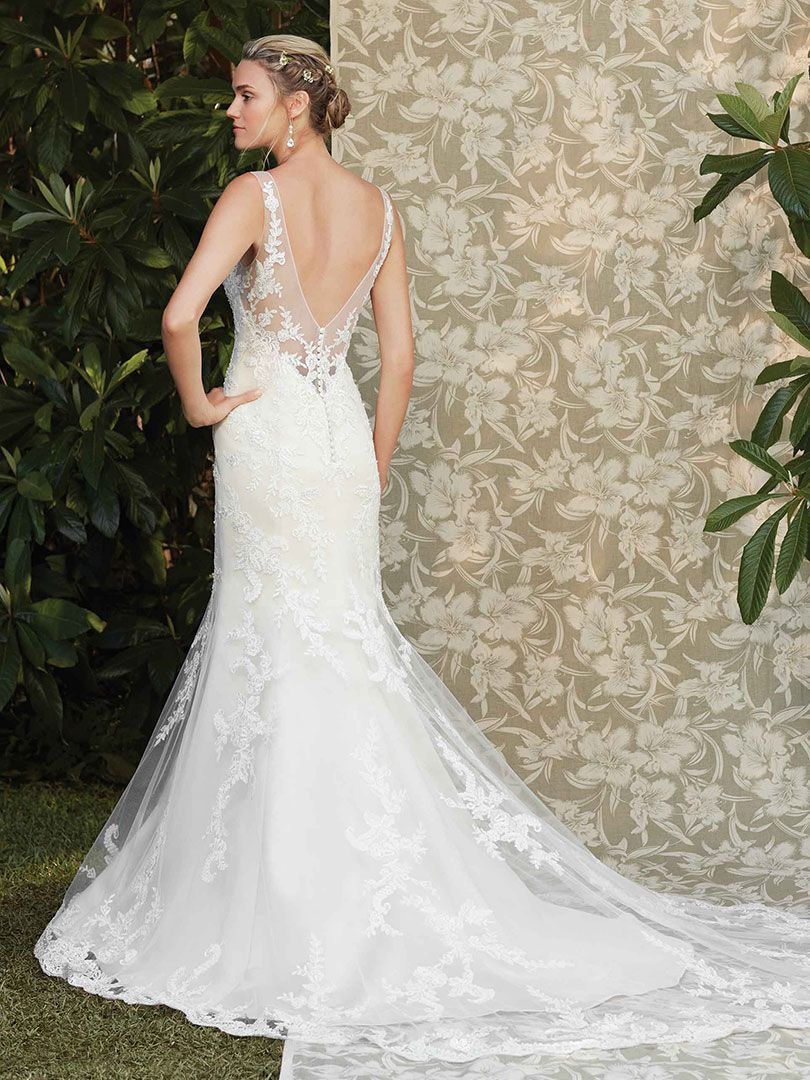 6b803285668 Ivy features perfecting satin fit and flare sheath under a lace appliqued  overlay