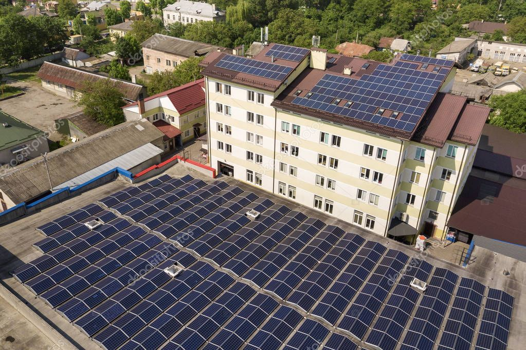 Aerial View Of Many Solar Panels Mounted Of Industrial Building Stock P Sponsored Solar Panels Solar Panel Mounts Industrial Buildings Solar Panels