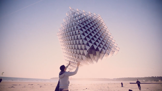 """""""Three Cubes Colliding"""" by Ivan Morison and Sash Reading. Kite that looks like a pyrite crystal. Made of aerospace fabric/1700 3-D printed connectors. Inspiration: Alexander Graham Bell's tetrahedral kite experiments."""
