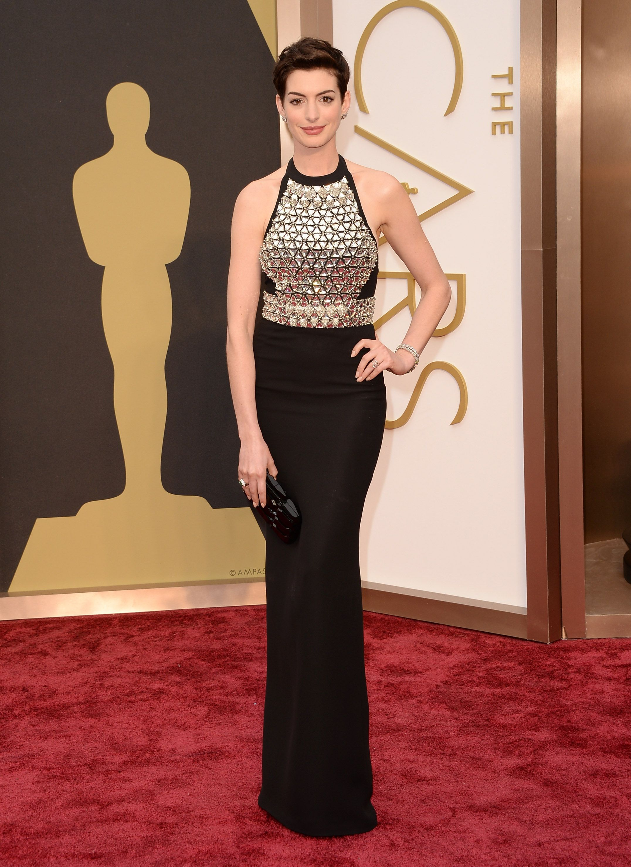 Anne Hathaway shines in a crystal-embroidered Gucci gown at the 86th Annual Academy Awards