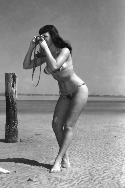 Today's über-cool, über-hot celebrity with an über-cool camera: pin-up queen BETTIE PAGE!