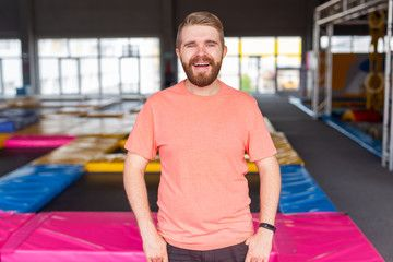 Fitness, fun, leisure and sport activity concept - Man smiling on a trampoline indoors , #Ad, #sport...