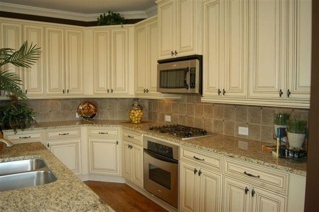 antique white cabinets with st cecilia light granite countertops