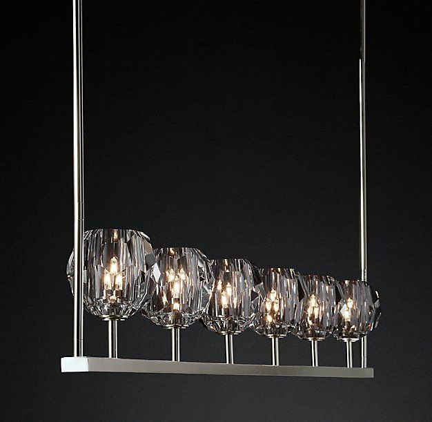 """RH Modern's Boule De Cristal Linear Chandelier 60"""":Crafted of solid brass and crystal, lighting designer Jonathan Browning's sculptural fixture is a testament to his passion for luxe materials and handcraftsmanship. Evoking the minimalist spirit of 1960s design, each faceted sphere is ground and polished by hand to reflect and refract the light."""