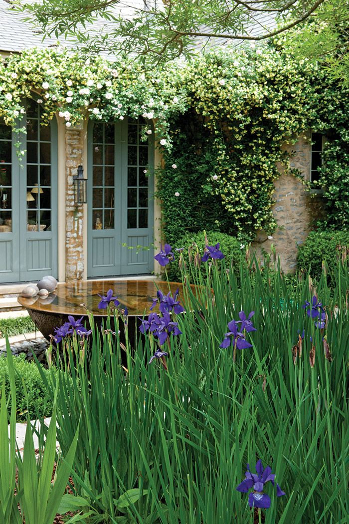 This Country-French garden blooms with legacy plants from two ...
