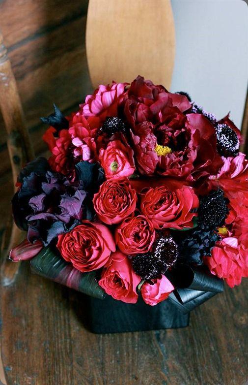 red flower arrangement of garden roses ranunculus and charm peonies sachi rose