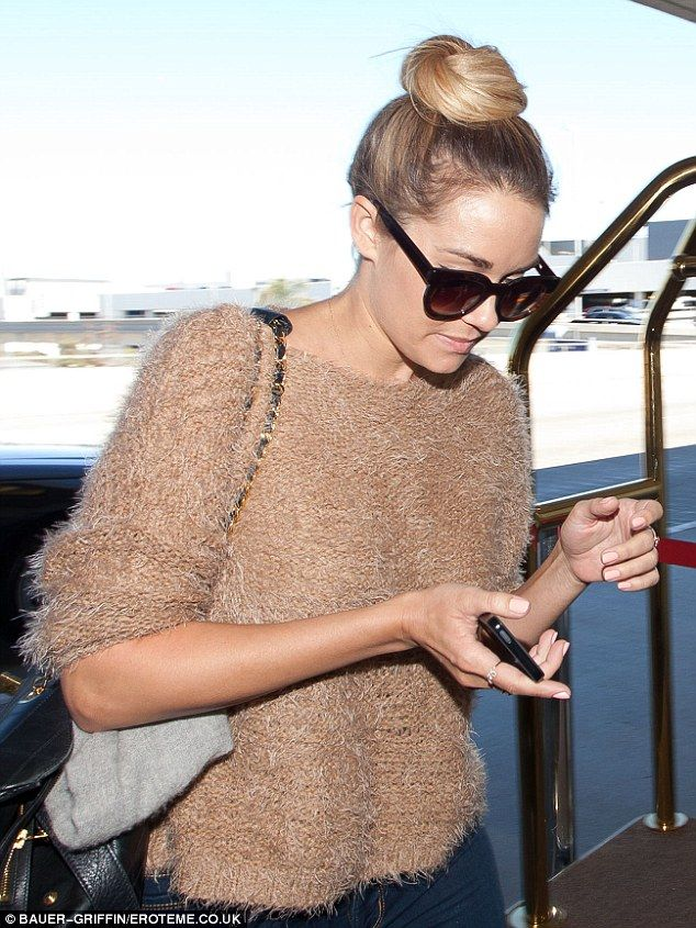 Lauren Conrad teams a sleek bun with a fuzzy jumper and skinny jeans