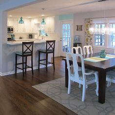 The wall that blocks off the kitchen is removed to allow for a small family breakfast bar, that ties in nicely with the open dining space. Removing the…