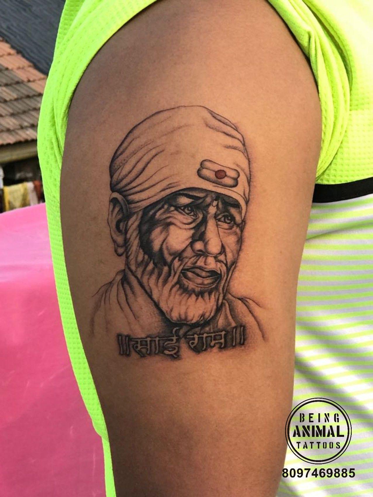 Sai baba tattoo by tattoo artist Sachin at being animal