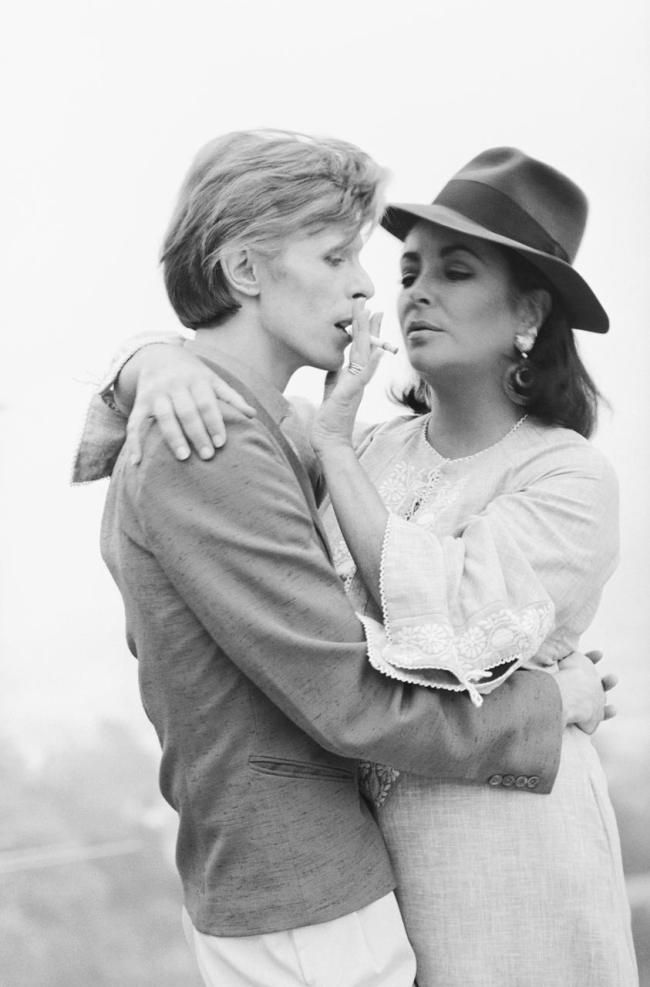 """""""On my wall, I have a shot of Taylor in her late forties. She is with David Bowie... As she puts a cigarette to Bowie's mouth, her face is both lascivious and maternal — her lips are half-open; you can practically hear her coo, """"Here you go, baby."""" In that one shot, she makes David Bowie – DAVID BOWIE – look like a helpless teenage boy."""" Caitlin Moran, Moranthology"""