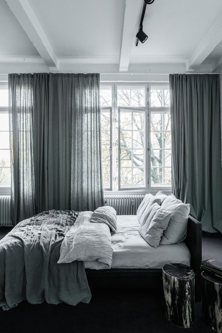 Airy bedroom with grayish green linen curtains