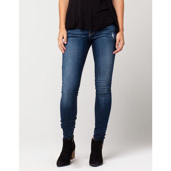 Dark wash destroyed skinny jeans