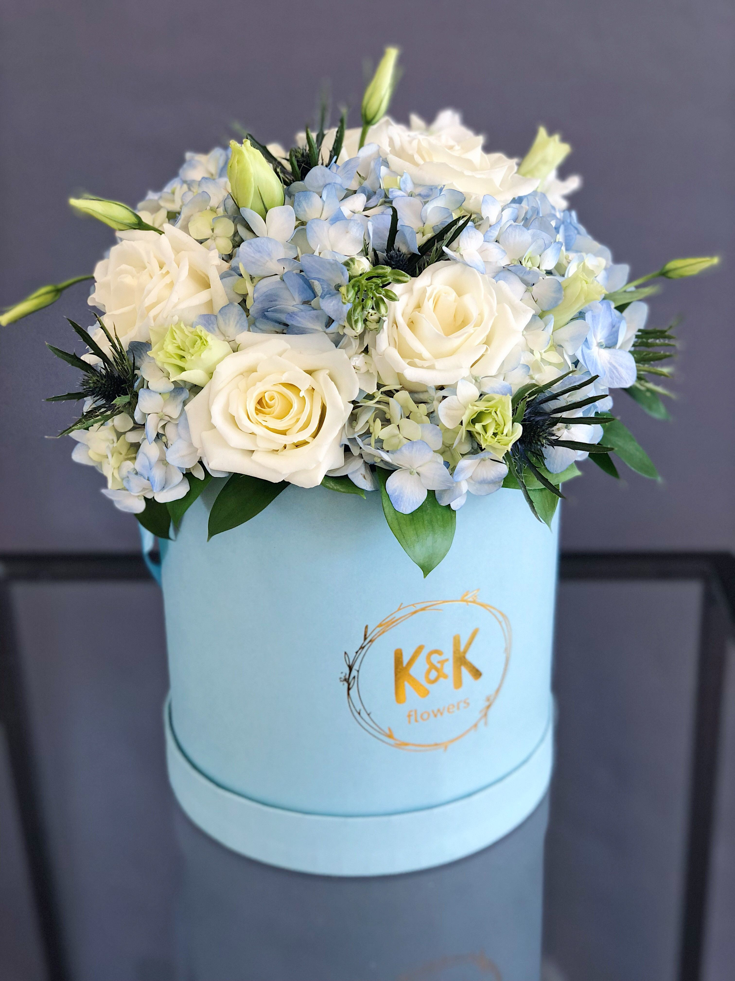 Medium blue hat box with white roses, blue hydrangeas and