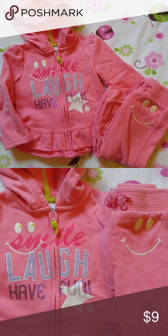 Smile SweatSuit Coral pink in color with sweet encouraging words, this size 18 months sweatsuit has glitter smiles on sweatshirt and pant. Cute ruffle hem on the sweatshirt. By Circo Matching Sets