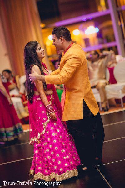 Indian couple dancing at their sangeet night. http://www.maharaniweddings.com/gallery/photo/94098