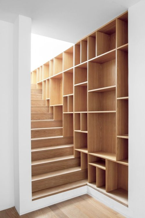 love the idea of the different sized shelves love this idea for basement or loft stairs great storage for books games etc - Wall Sized Bookshelves